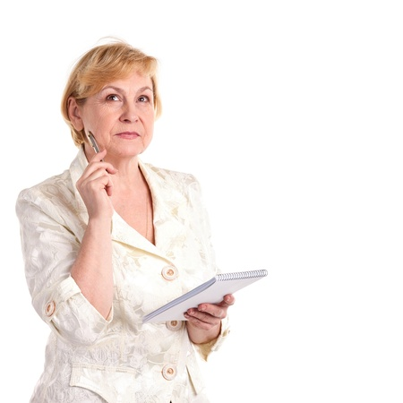 old notebook: Pretty mature businesswoman with pen and notebook isolated over white