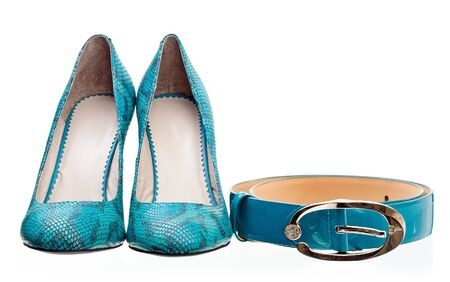 Pair of leather women shoes and belt isolated over white  photo