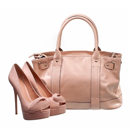 Beautiful platform shoes and handbag over white  photo