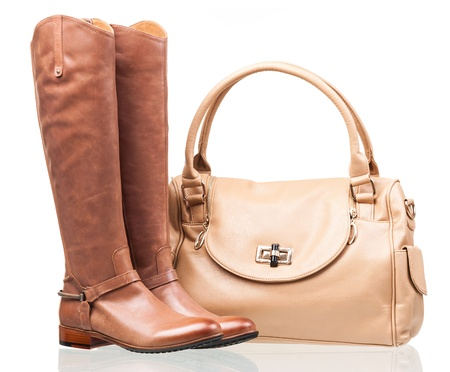 Women knee-high boots and leather bag over white Stock Photo