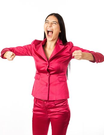 Joyful young woman celebrating success with clenched fists over white  photo