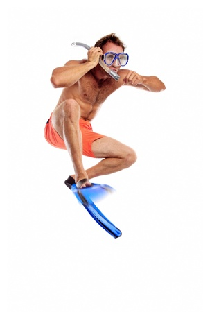 Caucasian swimmer wearing mask, snorkel and flippers jumping