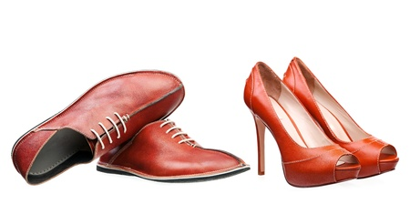 Male and female leather shoes isolated over white  photo