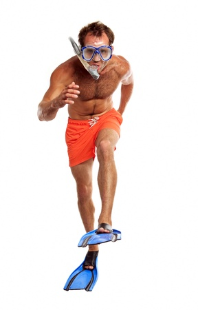 Caucasian swimmer wearing mask, snorkel and flippers walking photo