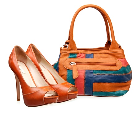 open toe: Pair of fashion women shoes and handbag over white