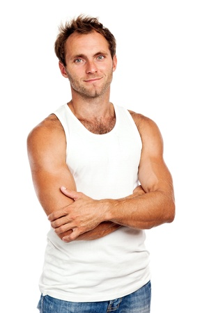undershirt: Portrait of handsome young man standing with arms crossed on white background Stock Photo