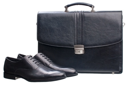 clasp feet: Pair of black men shoes and briefcase isolated over white  Stock Photo