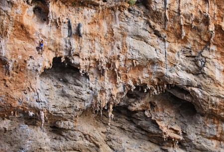 rock climb: Female rock climber on a cliff face  Stock Photo