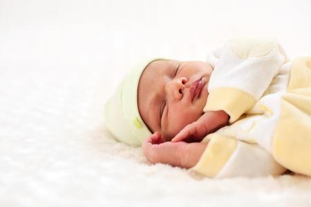 Close-up portret van een een week oude baby jongen in slaap Stockfoto