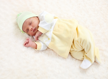 bed clothes: One week old baby boy asleep Stock Photo