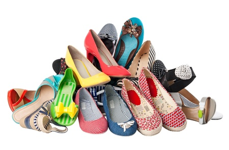 messy clothes: Pile of various female summer shoes isolated over white, with clipping path  Stock Photo