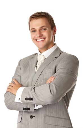 Young attractive man smiling brightly and standing with arms crossed  photo