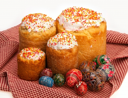 paskha: Easter cakes and painted eggs on dishcloth isolated over white