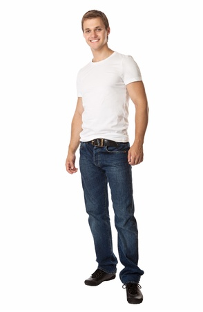 beautiful men: Full length of a cute young man in jeans and t-shirt looking at the camera, against white background  Stock Photo
