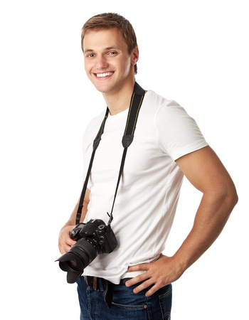 Portrait of a handsome young man with a camera against white background  photo