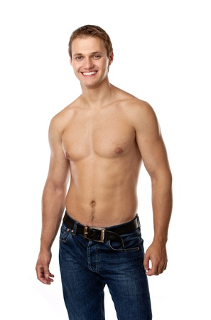 male torso: Cheerful young man in jeans with bare torso posing against a white background  Stock Photo