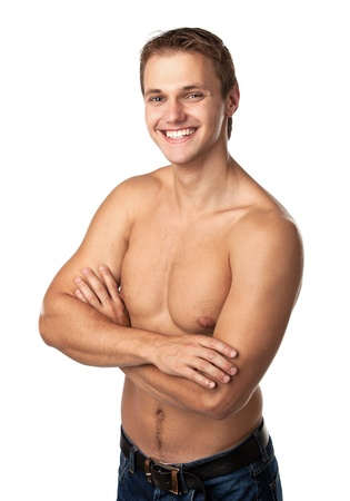 Cute smiling young guy in jeans with bare torso Stock Photo - 17729293