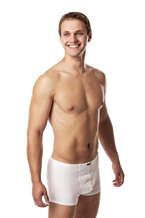 Handsome young man in underwear against white background  photo