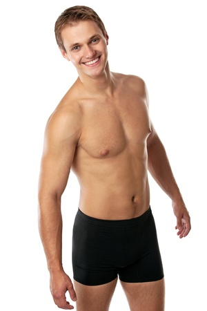man underwear: Cheerful young man in trunks over white background