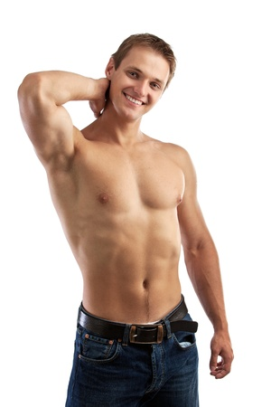 Cheerful young man in jeans with bare torso  photo