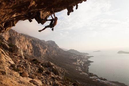 climbing: Escalador en puesta del sol, Isla de Kalymnos, Grecia