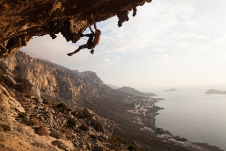 rock climb: Rock climber at sunset, Kalymnos Island, Greece
