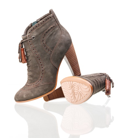 chamois leather: Pair of suede high heels boots over white