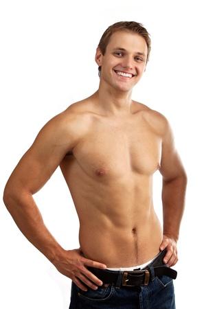 hombres sin camisa: Alegre hombre joven en pantalones vaqueros con el torso desnudo