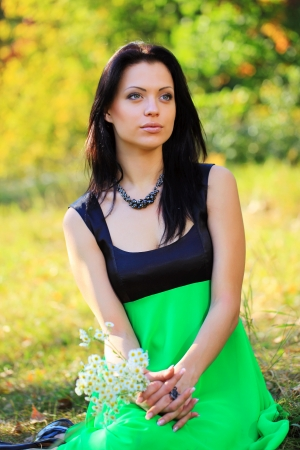 Portrait of a gorgeous young woman outdoors photo