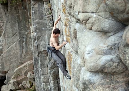 Rock climber struggling to make the next movement  Stock Photo - 16971031