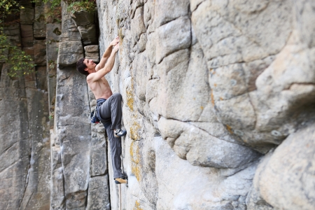 Rock climber struggling to make the next movement Stock Photo - 16971013