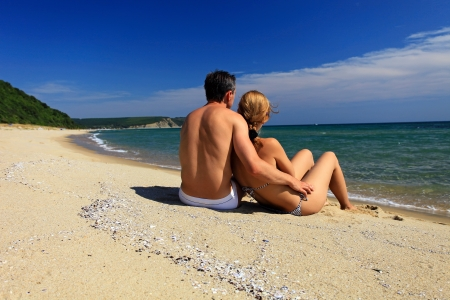 bikini couple: Rear view of young caucasian couple at the beach