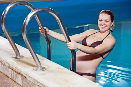 swimming suit: Young pregnant woman in a swimming pool  Stock Photo