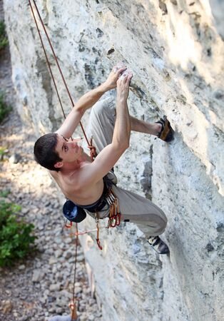 Rock climber focusing on the next movement Stock Photo - 16951147