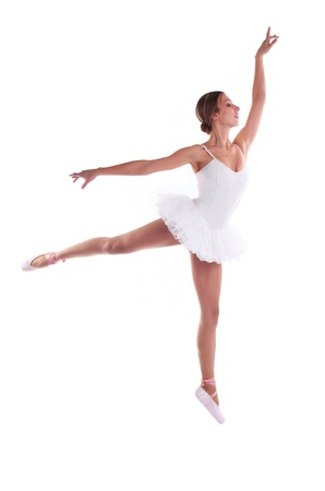 Young Caucasian ballerina jumping against white photo