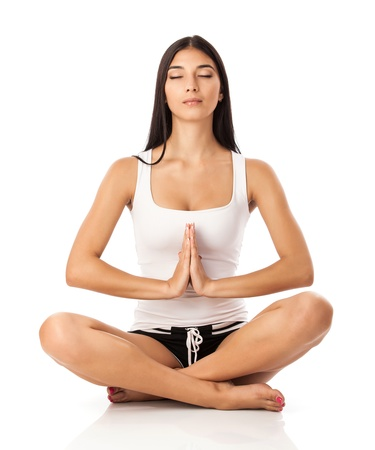 meditation isolated white:  Young woman sitting in lotus position