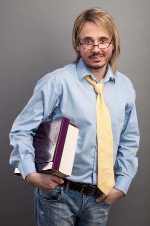 Portrait of handsome young man holding folder and book photo