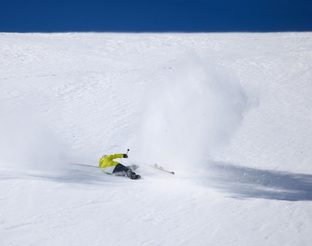 Skier falling down on mountain slope photo
