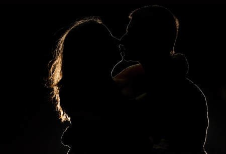 Silhouette of a young couple in the dark  photo