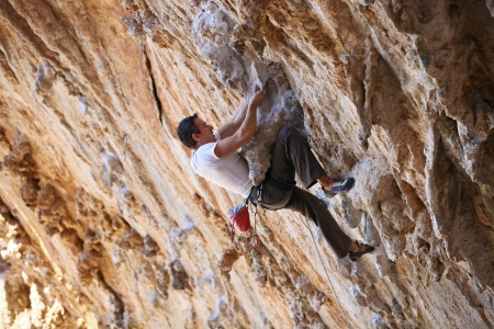 Rock climber on a face of a cliff Stock Photo - 17343950