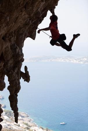 handhold: Rock climber jumping on next handhold, Kalymnos Island, Greece  Stock Photo
