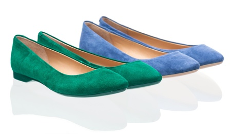 Pairs of green and blue pumps over white photo