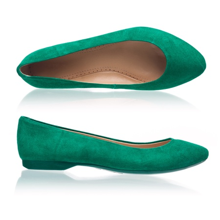 Green suede pumps over white  photo