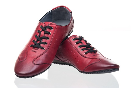 Red female shoes over white  Standard-Bild