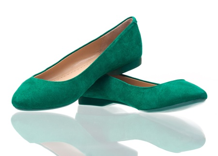 Pair of green suede pumps over white background photo