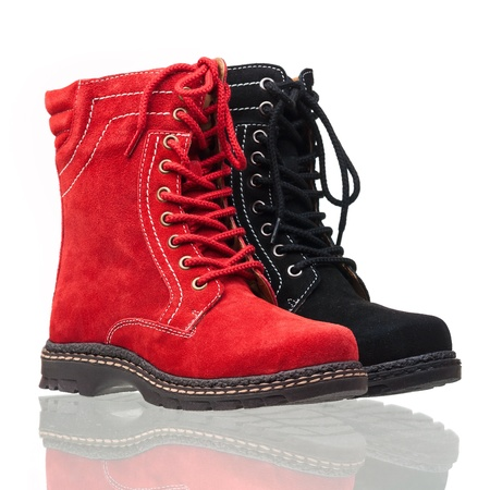 Red and black ankle high women boots over white  photo