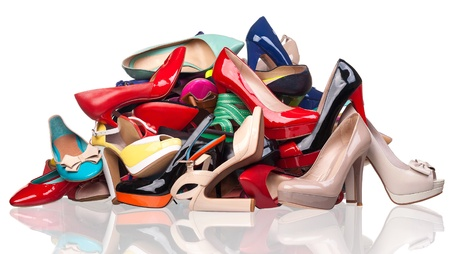 high heel: Pile of various female shoes isolated over white Stock Photo