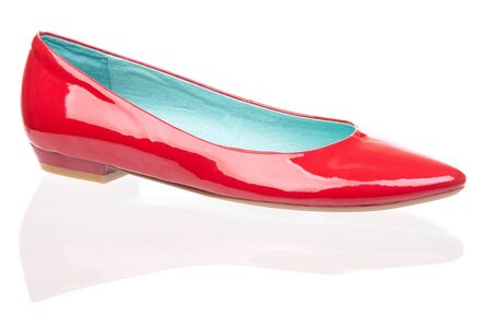 red shoes: Red patent leather pump over white background