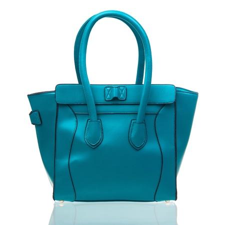 Blue female handbag over white background