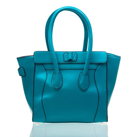 woman handle success: Blue female handbag over white background